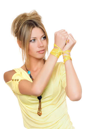 Portrait of lovely young blonde with bound hands photo