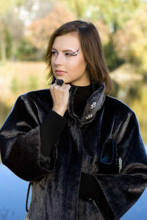 Portrait of a nice young woman in autumn park Stock Photo - 11370259