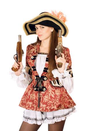 mujer pirata: Encantadora mujer joven con armas de fuego vestidos de piratas Foto de archivo