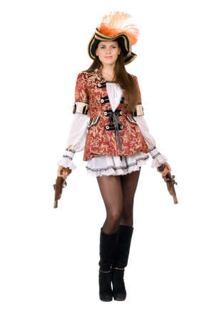 Pretty young woman with guns dressed as pirates Stock Photo