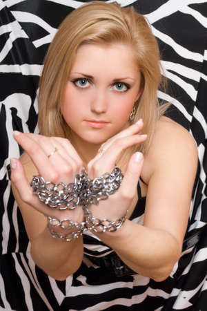 Sensual sexy blonde stretches out her hands in chains Stock Photo - 11819206