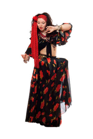 Sensual gypsy woman in a black skirt. Isolated  photo