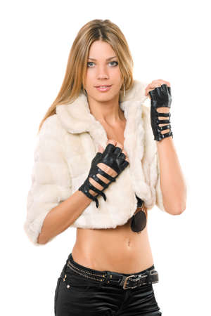 Portrait of attractive girl in a white fur coat photo