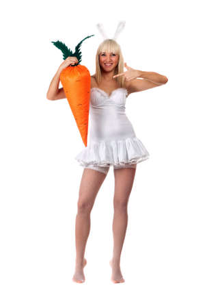 Smiling sexy young blonde with a carrot Stock Photo - 11819254