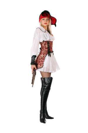 Young attractive blonde with gun dressed as pirates Stock Photo