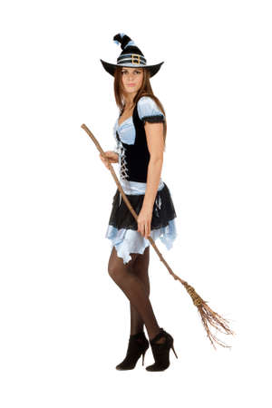 besom: Pretty young woman with a besom wearing costume witch
