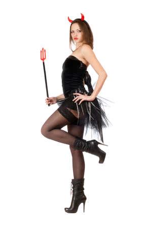 팬티 스타킹: 매혹적인 여자는 섹시한 악마 의상을 입고있다 스톡 사진