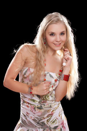 Portrait of a playful young blonde. Isolated photo