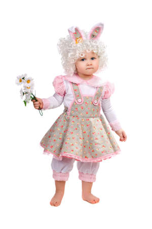 Little girl with flowers in hand wearing a dress Stock Photo