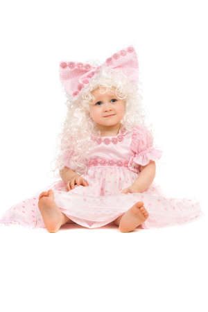 Baby girl in a pink dress. Isolated photo