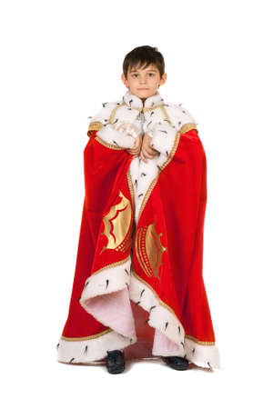 Boy dressed in a robe of King. Isolated on white Stock Photo