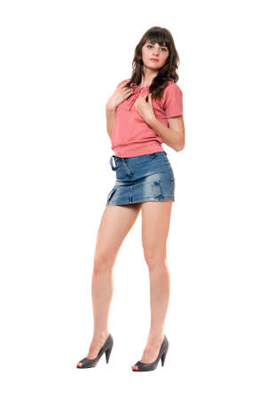 Beautiful girl in jeans mini skirt. Isolated photo