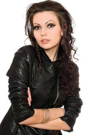 Portrait of nice young brunette in black clothes. Isolated photo