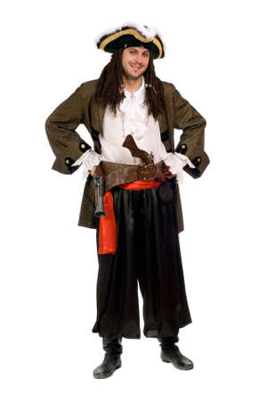 Smiling young man in a pirate costume with pistols Stock Photo