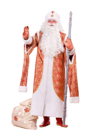'ded moroz': Russian Christmas character Ded Moroz (Father Frost) with the stick in his hands. Isolated on white Stock Photo