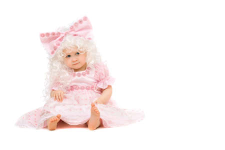 Baby girl in a pink dress. Isolated on white photo