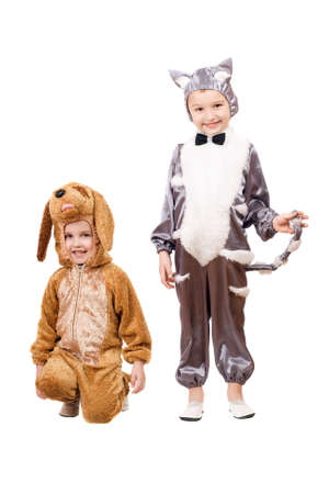 Playful boys dressed as a cat and dog. Isolated