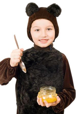 Niño disfrazado de oso con un tarro de miel Foto de archivo - 12177262