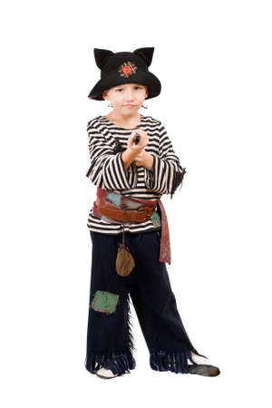 Little boy with gun dressed as a pirate. Isolated photo