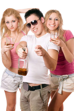 Happy young people with a bottle of whiskey. Isolated photo