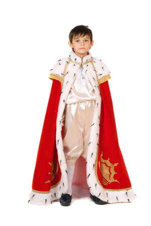 king: Little boy dressed in a robe of King Stock Photo