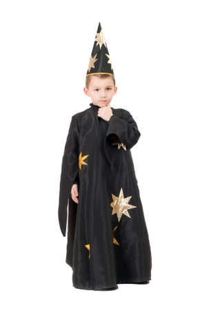 Boy dressed as astrologer. Isolated on white photo