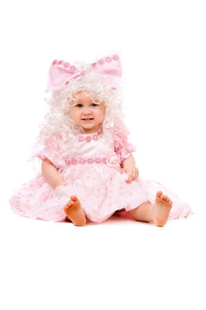 Funny baby girl in a pink dress photo