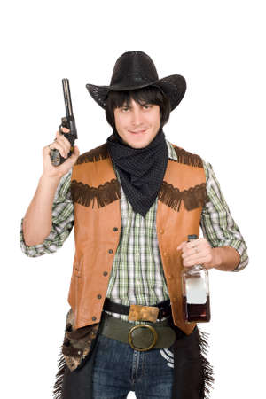 smirking: Portrait of smirking cowboy with a gun and bottle of whiskey in hands