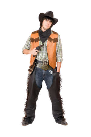 Cowboy with a gun in hand. Isolated on white photo