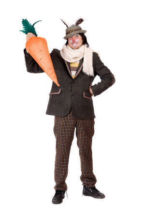 Young man with carrot dressed in a suit rabbit