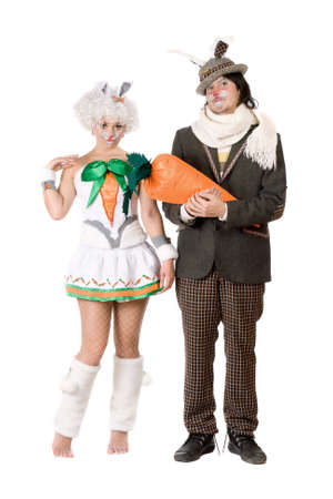 Funny couple dressed as rabbits. Isolated on white photo