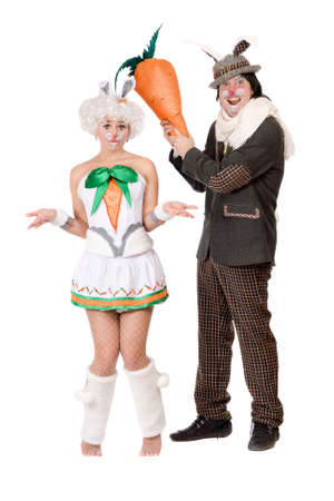 Funny couple with carrot dressed as rabbits photo
