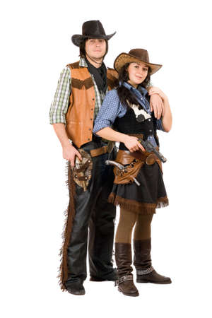 Young cowboy and cowgirl. Isolated on white background photo