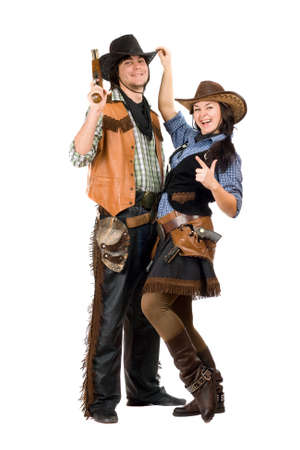 Cheerful young cowboy and cowgirl. Isolated on white photo