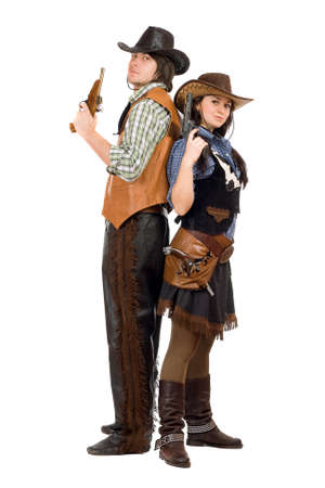 Young cowboy and cowgirl with a guns in hands. Isolated on white photo