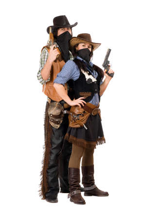 Couple of armed robbers in cowboy costumes. Isolated on white photo