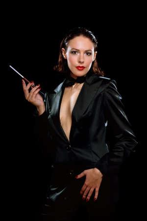 Beautiful young woman with cigarette wearing a black suit photo