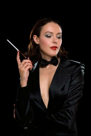 Attractive young woman with cigarette wearing a black suit