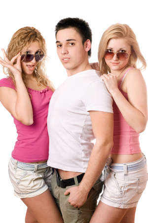Portrait of a two blonde women with handsome young man. Isolated photo