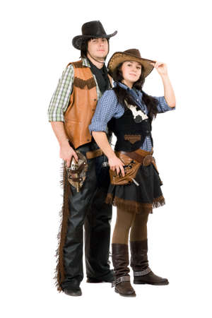 Young cowboy and cowgirl. Isolated on white photo