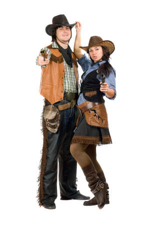 Young cowboy and cowgirl with a guns in hands