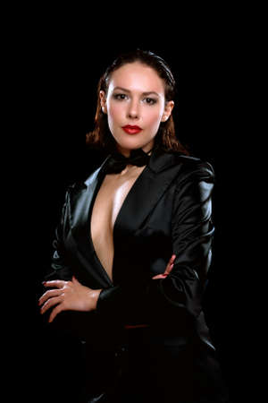 Beautiful young woman wearing a black suit photo