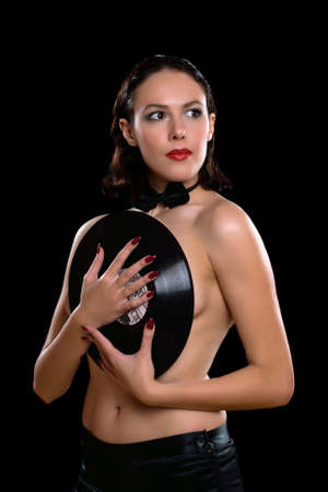 Nice young woman topless with vinyl. Isolated on black photo