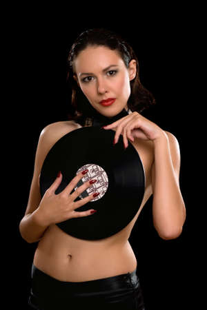 Sexy young woman topless with vinyl. Isolated on black photo