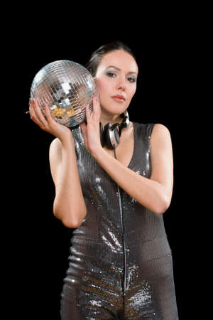 Portrait of nice young brunette with a mirror ball in her hands. Isolated on black photo