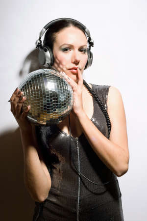 Portrait of nice brunette with a mirror ball in her hands photo