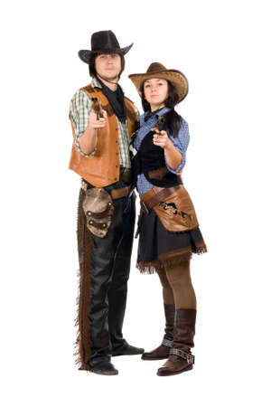 Young cowboy and cowgirl with a guns in hands. Isolated photo