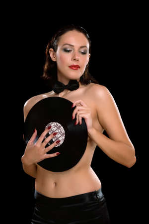 Sexy young woman topless with vinyl. Isolated photo