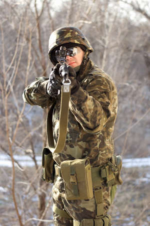 sight: Portrait of soldier with a gun in his hands