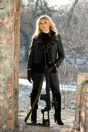 airsoft: Portrait of young pretty woman with a sniper rifle Stock Photo